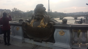The bridge gives us a good view of the Eiffel Tower in the distance