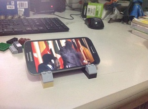 I needed a cradle to mount my phone on while watching episodes. Luckily I had some legos around