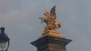 One of the golden statues watching over the Pont Alexander