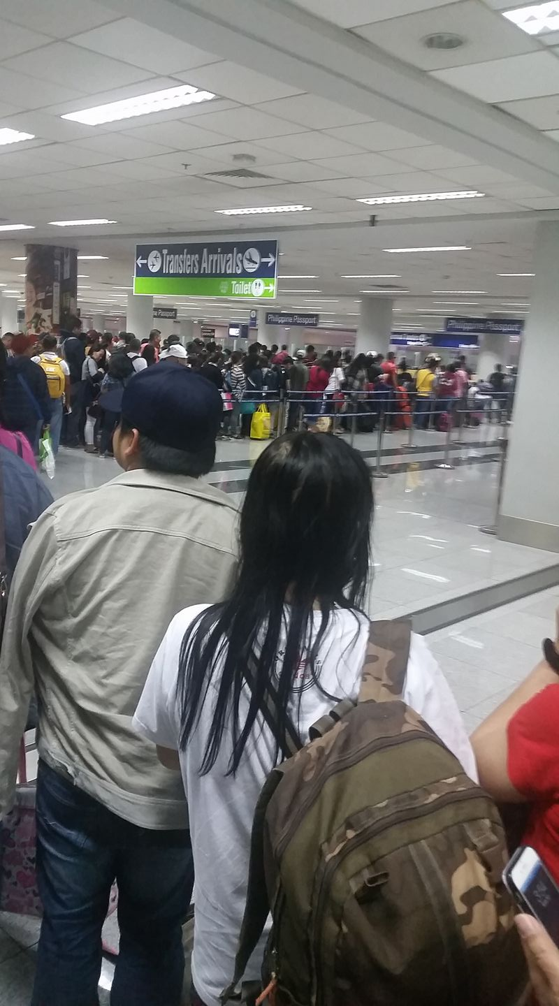 Immigration queue. Looks like only 4 counters manned